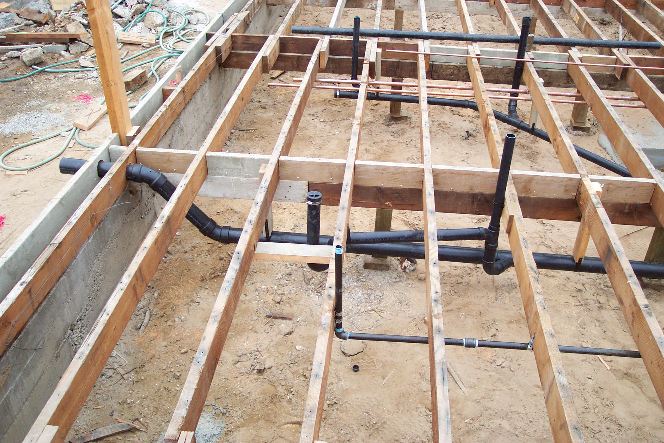 sub floor plumbing pipes and framing pictures